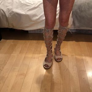 Knee high sandals by Marabelle